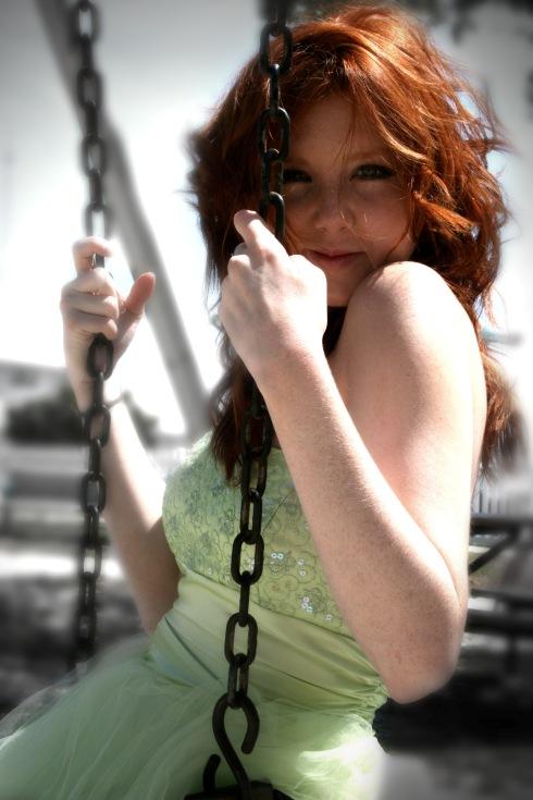 Redhead on a swing
